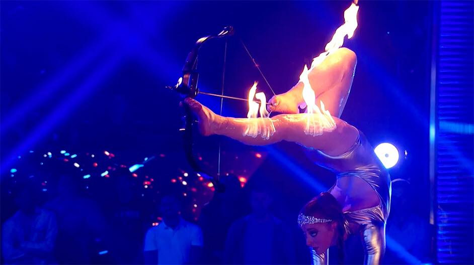 Hire unique Foot Archery act. Skilled stunning performer. Acrobacy and foot archery