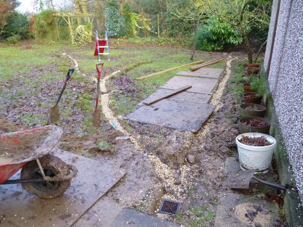 Work underway to drain garden.JPG