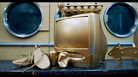 Two friends discover a washing machine that turns everything in to solid gold. But things quickly go downhill as greed gets the better of them.