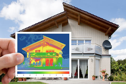 A man holding a picture that shows the thermal heat transfer occuring in th home