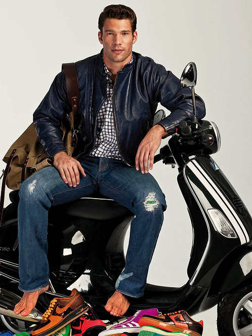 Aaron O'Connell on a Scooter