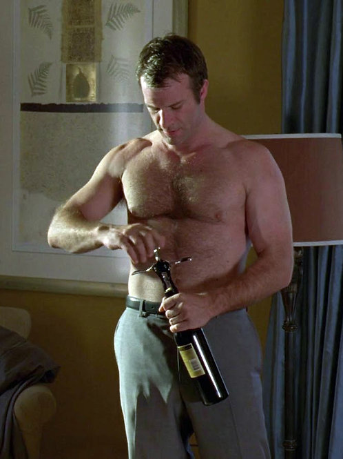 Bulging Thomas Jane Opening Wine in the Show Hung