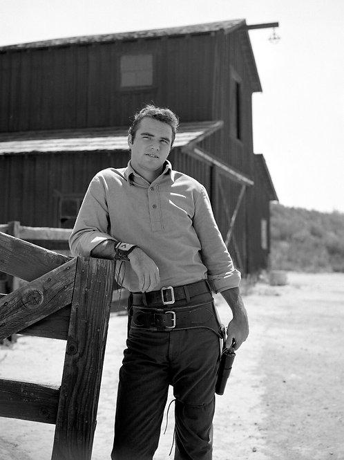 Burt Reynolds Standing by a Barn in Gunsmoke