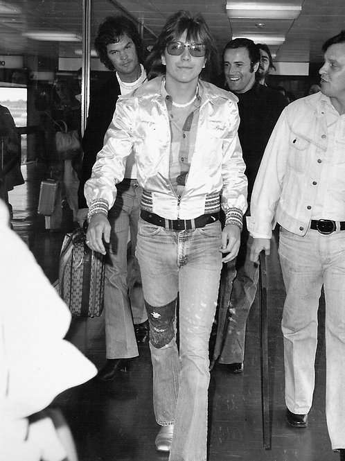 Bulging David Cassidy Surrounded by Security in 1974