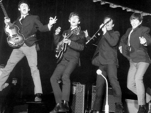 Beatles Performing on Stage in the 1960s