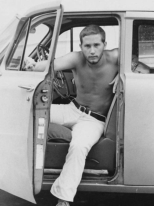 Vintage Bulging Crawford Barton Exiting a Car
