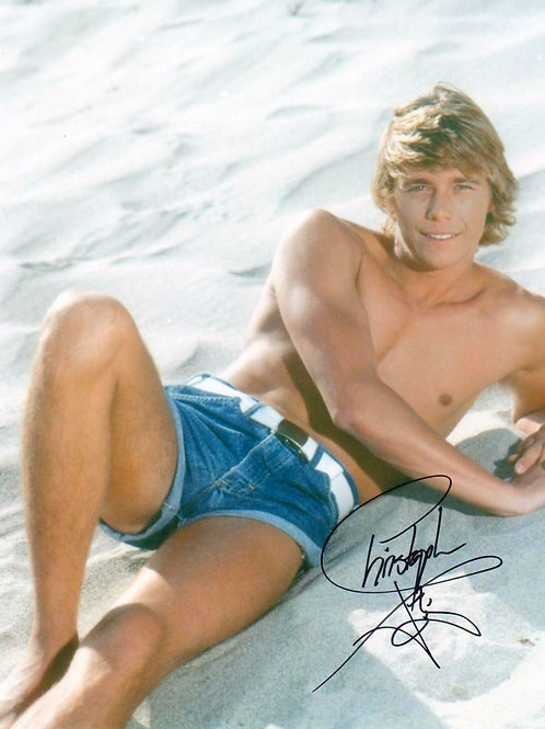 Christopher Atkins Laying on a Beach