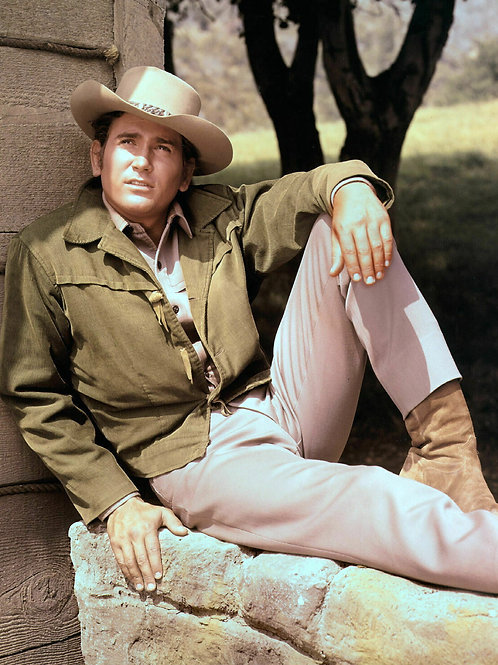 Michael Landon Sitting on a Stone Wall