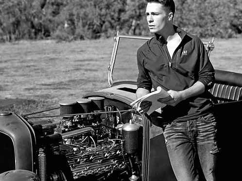 Colton Haynes by a Hot Rod