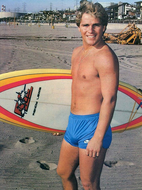Bruce Penhall Carrying a Surfboard