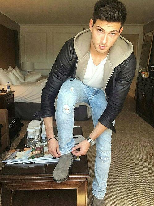 Adjusting his Pants Cuff