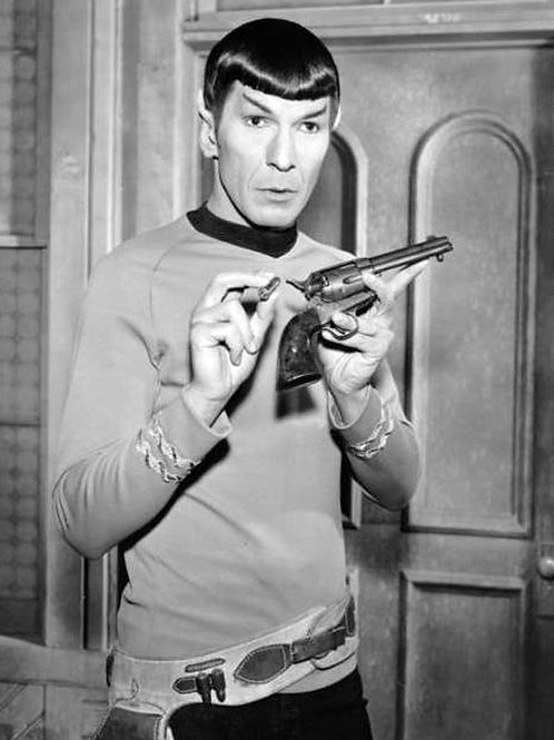 Leonard Nimoy with his pistol on the set of Star Trek, 1968
