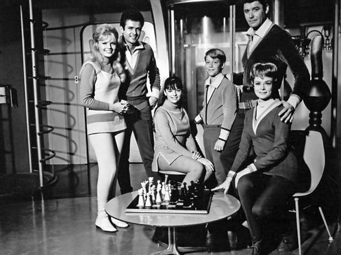 Cast of Lost in Space Sitting on the Upper Deck