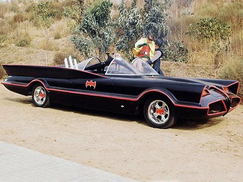 Adam West as Batman Carrying Robin to the Batmobile