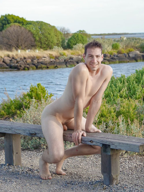 Nude Dude Stradling a Bench