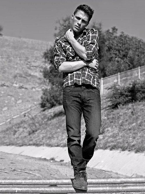 Colton Haynes Balancing on a Fence
