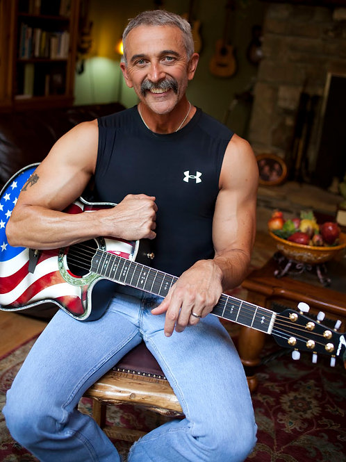 Bulging Aaron Tippin with his USA Guitar