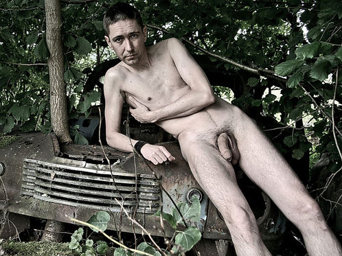 Leaning Naked on a Junk Car