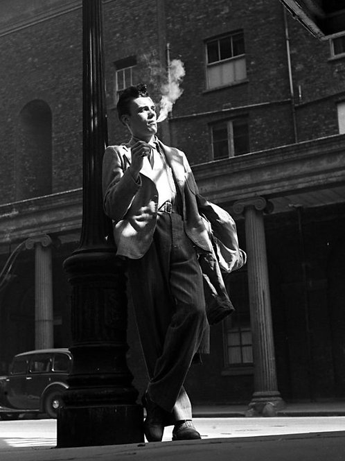 Dirk Bogarde Smoking by a Lampost in 1947