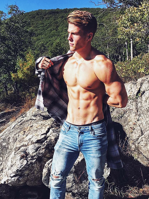Hunk in the Mountains Removing his Shirt
