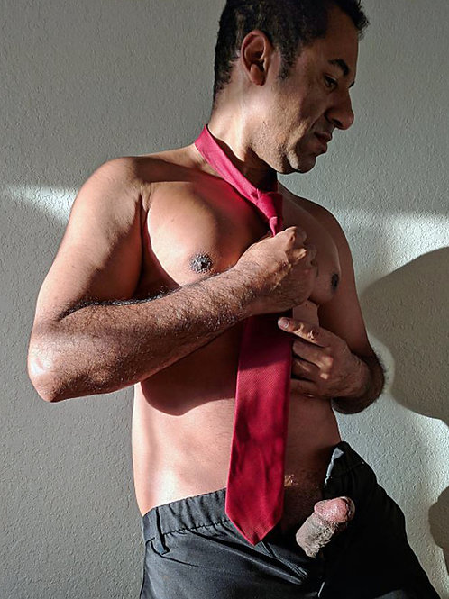 Tying his Red Tie