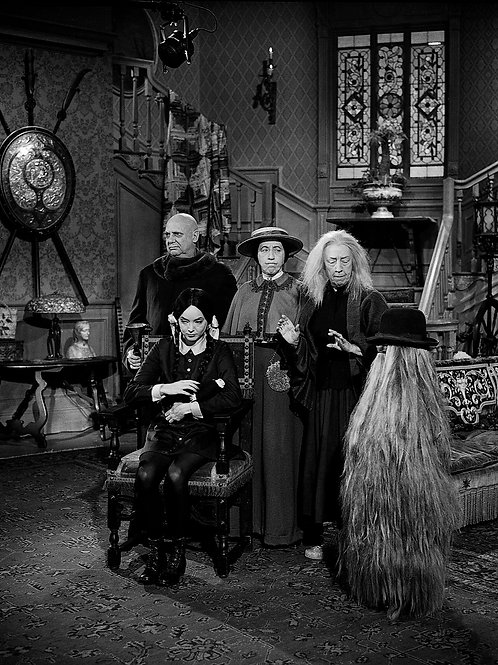 Cast of the Addams Family with Cousin It in the Living Room