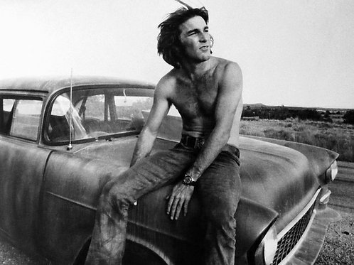 Shirtless Dennis Wilson Sitting on the Hood of an Old Car
