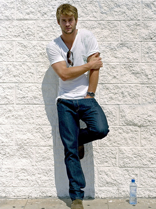Chris Hemsworth in Jeans & a Tshirt Leaning on a Wall