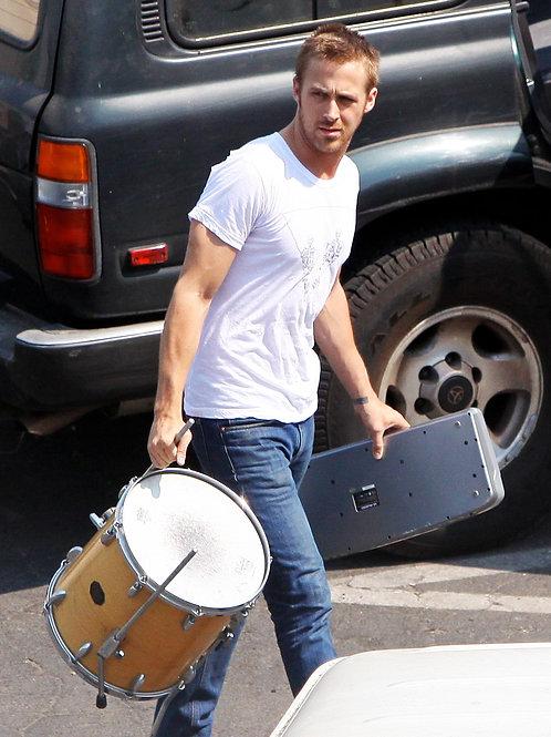 Ryan Gosling Carrying a Drum