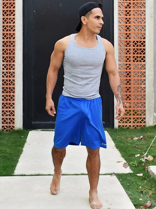 Barefoot in Blue Shorts