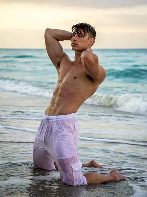 Kneeling on the Beach