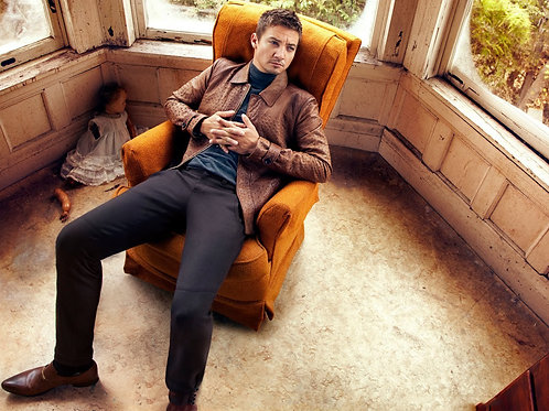 Jeremy Renner Relaxing on an Orange Chair