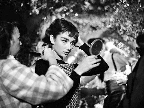 Audrey Hepburn Fixing Her Hair for a Scene