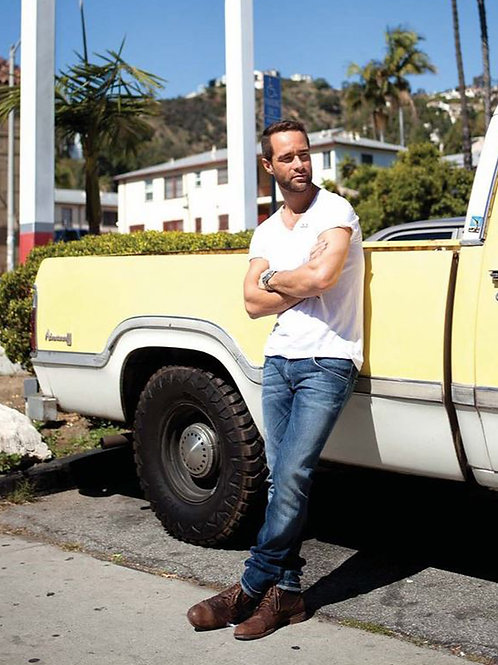 Chris Diamantopoulos Leaning on a Truck