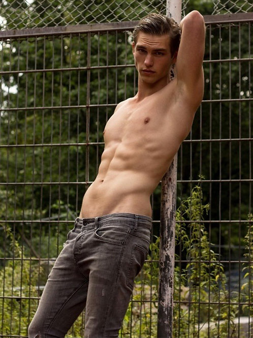 Adam Kai Leaning on a Fence