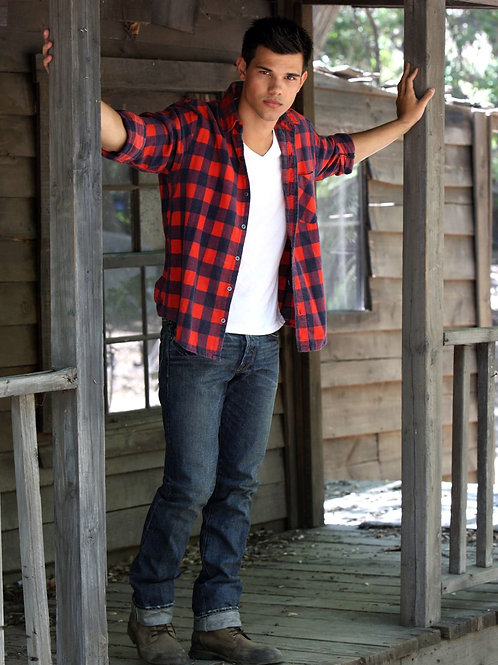 Taylor Lautner Standing on a Porch