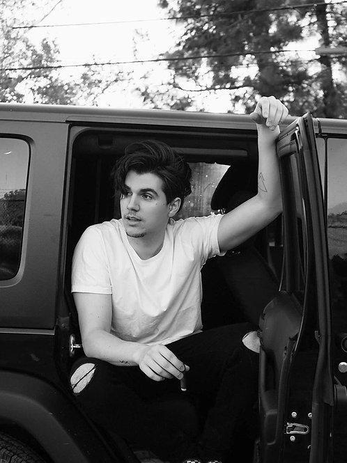Christian Delgrosso Sitting in an SUV