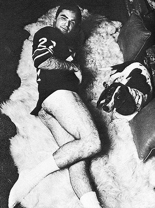 Burt Reynolds Laying on a Fur Rug
