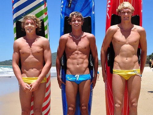 3 Cute Surfers with Their Boards