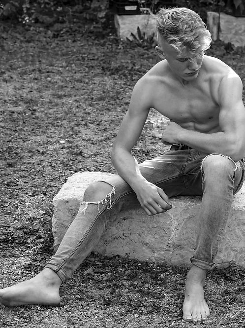 Twink In Old Jeans Sitting on a Rock