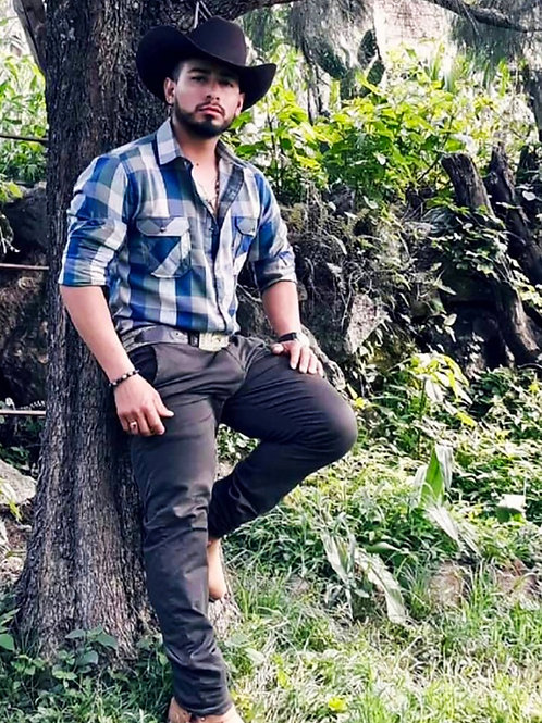 Cowboy Against a Tree