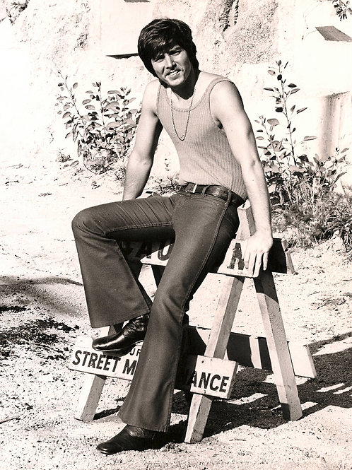 Bobby Sherman in Tight Jeans Sitting on a Sawhorse