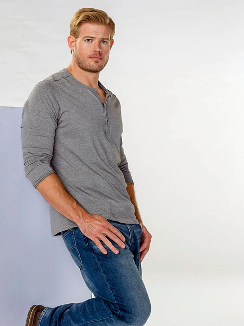 Trevor Donovan Bulging in Jeans Leaning on a Wall