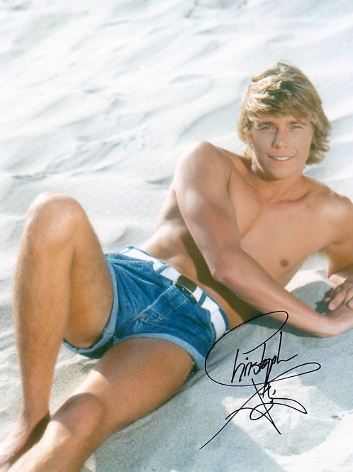 Christopher Atkins Shirtless Laying on a Beach