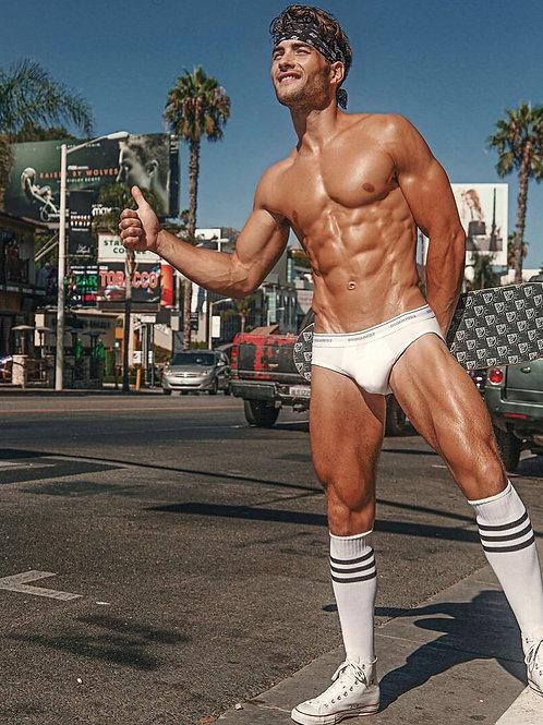 Joe Bruzas Hitchhiking in his Briefs