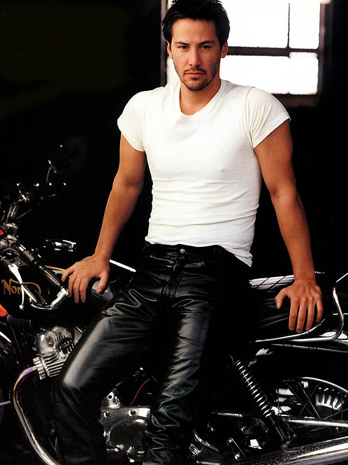 Keanu Reeves Wearing Leather Pants Leaning on a Motorcycle