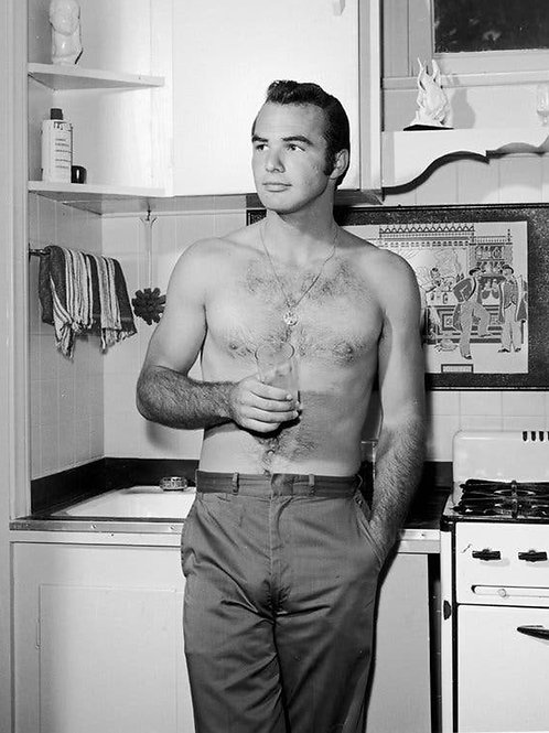 Young Shirtless Burt Reynolds in a Kitchen