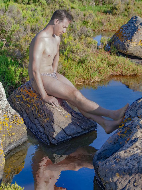 Nude Dude Sitting on a Rock in the Creek