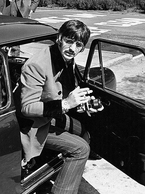 Ringo Starr Exiting a Car Holding a Camera