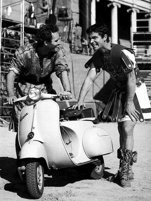 Charlton Heston and Stephen Boyd riding a Vespa in 1959